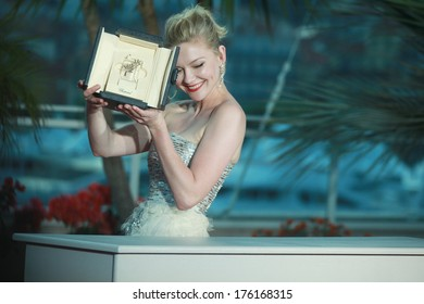 CANNES, FRANCE - MAY 22: Actress Kirsten Dunst with her Award for Best Actress in the film 'Melancholia' during photocall at the 64th Annual Cannes Film Festival on May 22, 2011 in Cannes, France.