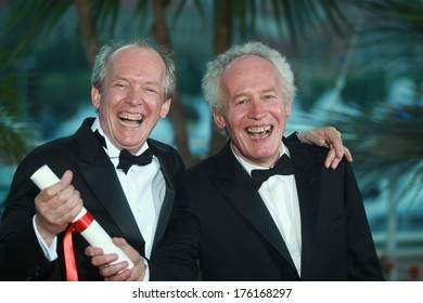 CANNES, FRANCE - MAY 22: Luc Dardenne and Jean-Pierre Dardenne durings the Palme D'Or Winners Photocall at the 64th Annual Cannes Festival at the Palais on May 22, 2011 in Cannes, France