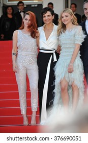 """CANNES, FRANCE - MAY 23, 2014: Juliette Binoche, Kristen Stewart & Chloe Grace Moretz at gala premiere of their movie """"Clouds of Sils Maria"""" at the 67th Festival de Cannes."""