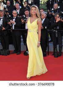"""CANNES, FRANCE - MAY 23, 2014: Amy Willerton at gala premiere of """"Clouds of Sils Maria"""" at the 67th Festival de Cannes."""