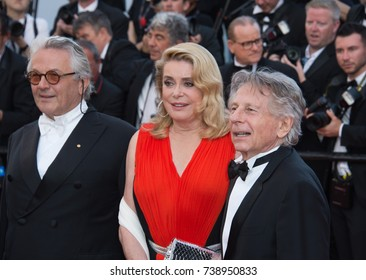 CANNES, FRANCE. May 23, 2017: George Martin, Catherine Deneuve & Roman Polanski at the 70th Anniversary Gala for the Festival de Cannes