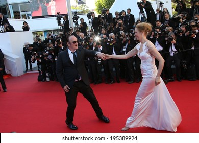 CANNES, FRANCE - MAY 24: Quentin Tarantino and Uma Thurman attend the Closing Ceremony and 'A Fistful of Dollars' Screening during the 67th Cannes Film Festival on May 24, 2014 in Cannes, France.