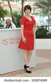 "CANNES, FRANCE - MAY 25, 2012: Emily Hampshire at the photocall for ""Cosmopolis"" in Cannes. May 25, 2012  Cannes, France"