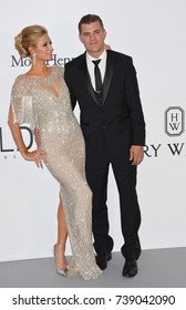 CANNES, FRANCE. May 25, 2017: Paris Hilton & Chris Zylka at the 24th amfAR Gala Cannes at the Hotel du Cap-Eden-Roc, Antibes