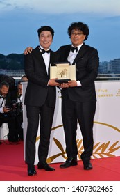 CANNES, FRANCE. May 25, 2019: Bong Joon-Ho & Song Kang-ho at the Palme d'Or Awards photocall at the 72nd Festival de Cannes.Picture: Paul Smith / Featureflash