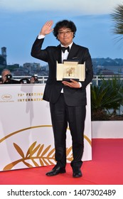 CANNES, FRANCE. May 25, 2019: Bong Joon-ho  at the Palme d'Or Awards photocall at the 72nd Festival de Cannes.