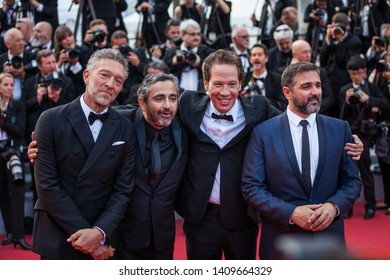 CANNES, FRANCE - MAY 25, 2019: Vincent Cassel, French directors Eric Toledano and Olivier Nakache, French actor Reda Kateb arrive for the Closing Awards Ceremony of the 72 annual Cannes Film Festival