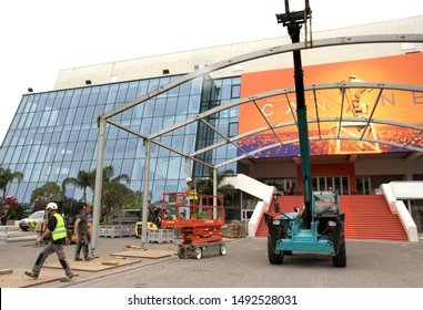 CANNES, FRANCE - MAY 27, 2019: workers clean the scenery after the closing of the 72nd International Film Festival at the Palais des Festivals and Congress.