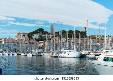 CANNES, FRANCE - OCTOBER 23, 2017: Luxury yachts in the Le Vieux port of Cannes in front of the old town