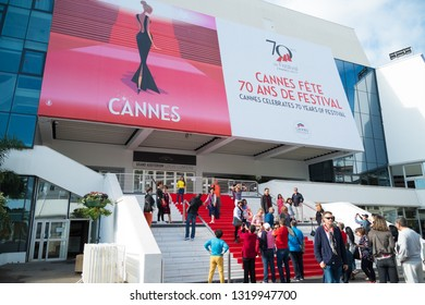 CANNES, FRANCE - OCTOBER 26, 2017: Tourists making pictures on the famous red carpet stair of the Grand Auditorium Louis Lumiere