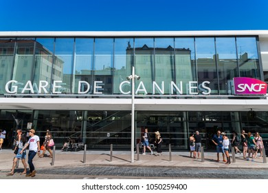 """Cannes, France - Sept 4, 2017: Passengers in front of the entrance to """"Gare de Cannes"""" which means Cannes Train Station which is located in Cannes, Cote d'Azur, France."""