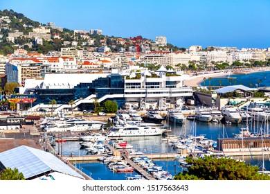 CANNES, FRANCE - September 20, 2019:  Aerial view of the luxurious port of Cannes and the Palais des Festivals et des Congrès, seen from the medieval castle (Musée de la Castre)