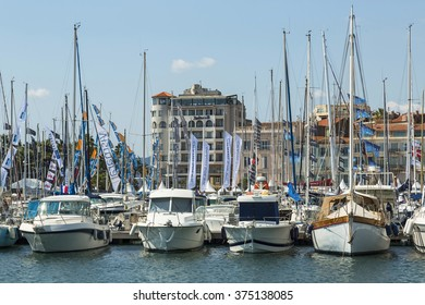 CANNES, FRANCE - SEPTEMBER 9th, 2015.  Yachts anchored in Port Pierre Canto at the Boulevard de la Croisette in Cannes, France. YACHTING FESTIVAL 2015, Cannes.