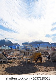 CANNES, FRANCE-SEPT. 22: Tourists are seen lounging and sunbathing on the beach at Cannes, France, The French Riviera on September 22, 2016.