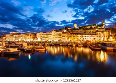 Cannes port aerial panoramic view at night. Cannes is a city located on the French Riviera or Cote d'Azur in south France.