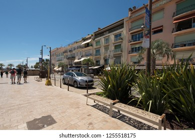 Cannes/France - August 5 2016: Quai Saint-Pierre street, near the old port in Cannes. Cannes is a city located on the French Riviera known for its association with the rich and famous.