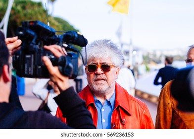 CANNES,FRANCE-MAY 14: spanis director Almodovar walks in the croisette of cannes directed to the palace of festival on the 14th of may 2010 in Cannes,France