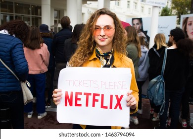 CANNES,FRANCE-MAY 18:  young model show a text asking tickets to netflix, ironically criticizing the lack of netflix production at cannes festival 2019