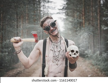 Cannibal Man in glasses with ax, skull and rope outdoor