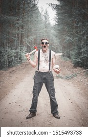 Cannibal Man in glasses with ax and skull screaming outdoor
