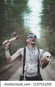 Cannibal Man in glasses with skull and rope outdoor