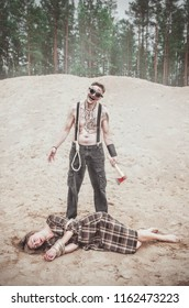 Cannibal steampunk Man with ax and his victim outdoor