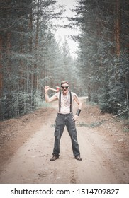 Cannibal steampunk Man in glasses with ax in forest outdoor