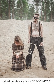 Cannibal steampunk Man and his victim outdoor