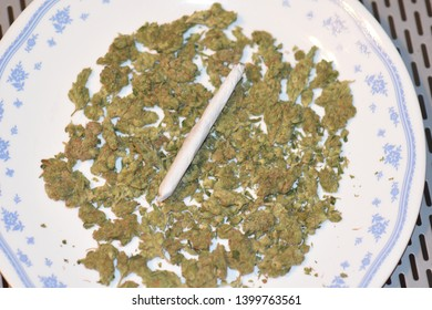 Cannibis on Plate with Rolled Joint