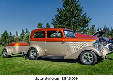 Canning, Nova Scotia,  Canada - September 23, 2018 : 1933 Ford Tudor streetrod with trailer on display at The Lookoff Campground Show & Shine, Canning, Nova Scotia.