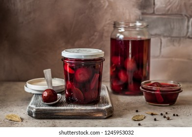 Canning Pickled Plums in Marinade with Bay Leaf, Garlic and Black Peppercorns, copy space for your text