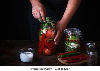 Canning process tomato preserve chili peppers hands add aromatic herbs glss jars pickle preserve canning food