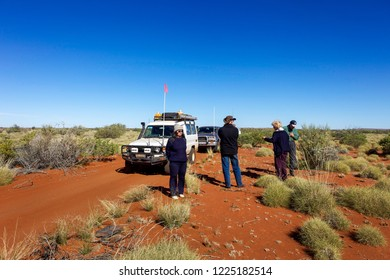 Canning Stock Route, Western Australia - August 15, 2010: People in a 4WD convoy stop for fuel at well 23 on the Canning Stock Route in outback WA.