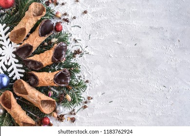 Cannoli with Christmas decoration and blank space,selective focus