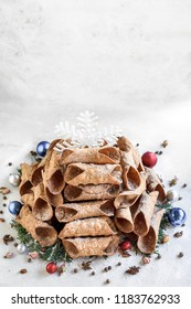 Cannoli Christmas tree on the table with blank space,selective focus