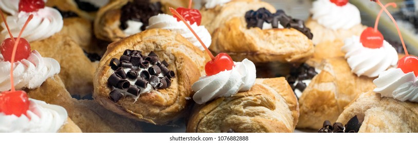 Cannoli with whip cream, cherries and chocolate chips