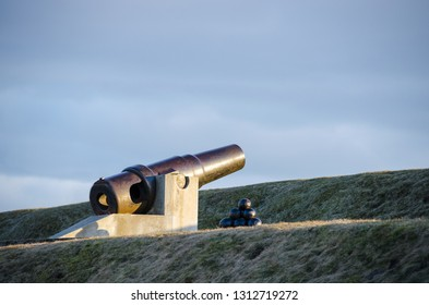 Cannon of 1877 with artificial cannonballs on the rampart of Daugavpils Fortress in early spring.