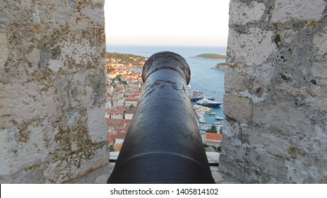Cannon and aerial view of Hvar Town viewed from the The fort Fortica (Spanjola), Dalmatia, Croatia. Elevated fortress with panoramic views of city, islands and sea.