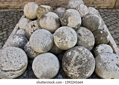 Cannon balls in white marble. A pile of marble balls used for catapults or cannons. Rome, Italy.  A pile of marble balls used for catapults or cannons.