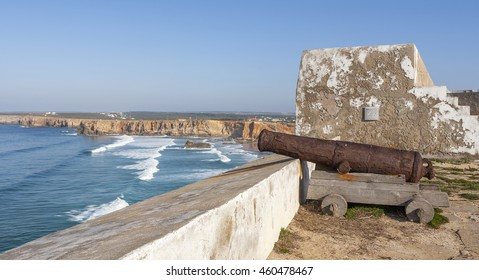 A cannon keeps watch at the 15th century Fortaleza de Sagres at Sagres Point in the Algarve, Portugal, which was built by Infante D Henrique, or Henry the Navigator, and restored in the 20th century.