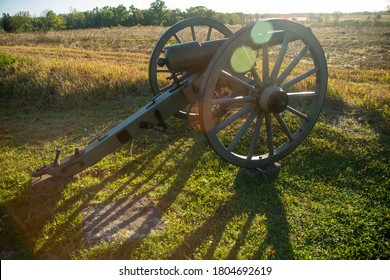 Cannon on Battlefield with Light Halation from Sun