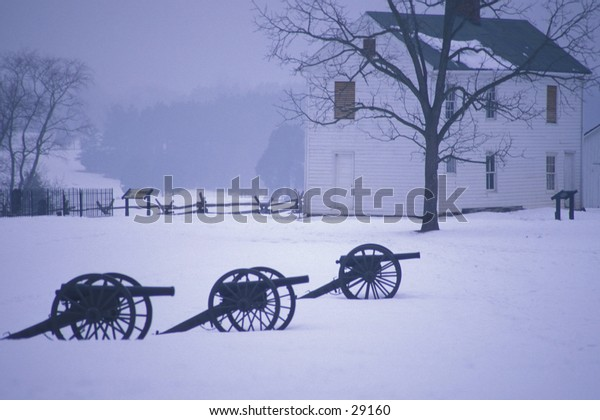 Cannon on the Civil War battlefield of Manassas (Bull Run) in the winter, with Henry House in background, near Manassas, Virginia
