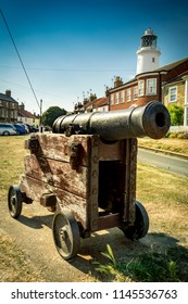 Cannon on green in front of Southwold lighthouse in Suffolk