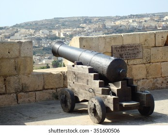 Cannon on ramparts, The Citadel, Victoria (Rabat), Gozo, Malta, Europe (sign on wall is in Maltese and English and is St. Martin's Demi-Bastion in English)
