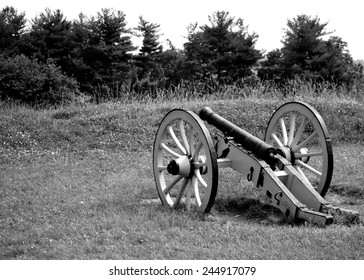 Cannon overlooking tree line