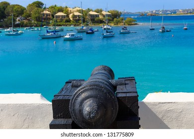 Cannon pointing at ships in the Caribbean Sea