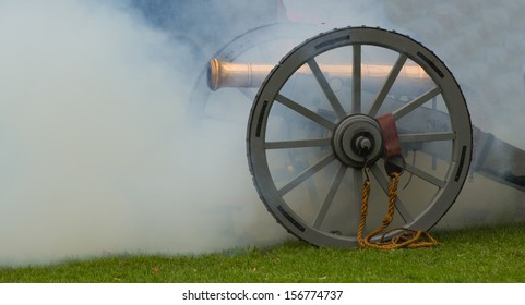 Cannon with smoke after firing