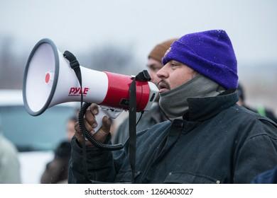 CANNONBALL, NORTH DAKOTA, USA - NOVEMBER 26, 2016: A Dakota Access Pipeline protester speaking to a crowd using a megaphone.