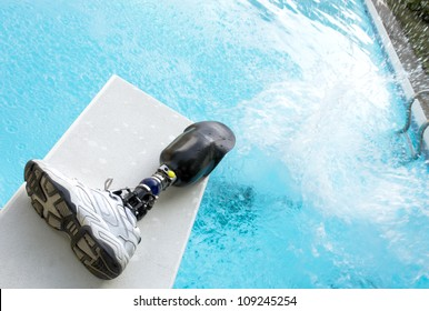 Cannonball splash in a pool with prosthetic leg left on diving board.