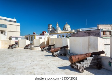 Cannons lined up on a fort in the center of Campeche, Mexico